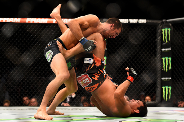 NEWARK, NJ - APRIL 18:  Luke Rockhold and Lyoto Machida of Brazil grapple in their middleweight bout during the UFC Fight Night event at Prudential Center on April 18, 2015 in Newark, New Jersey.  (Photo by Jeff Bottari/Zuffa LLC/Zuffa LLC via Getty Images)