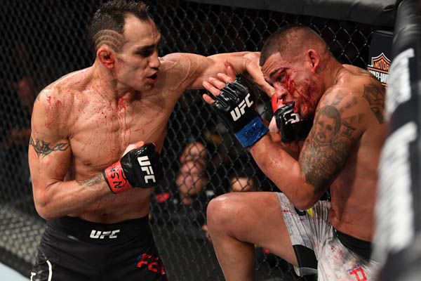 LAS VEGAS, NV - OCTOBER 06:  Tony Ferguson punches Anthony Pettis in their lightweight bout during the UFC 229 event inside T-Mobile Arena on October 6, 2018 in Las Vegas, Nevada.  (Photo by Josh Hedges/Zuffa LLC)