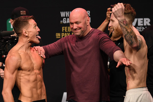 MELBOURNE, AUSTRALIA - FEBRUARY 09:  (L-R) <a href='../fighter/shane-young'>Shane Young</a> of New Zealand and <a href='../fighter/austin-arnett'>Austin Arnett</a> face off during the UFC 234 weigh-in at Rod Laver Arena on February 09, 2019 in the Melbourne Australia. (Photo by Jeff Bottari/Zuffa LLC/Zuffa LLC via Getty Images)