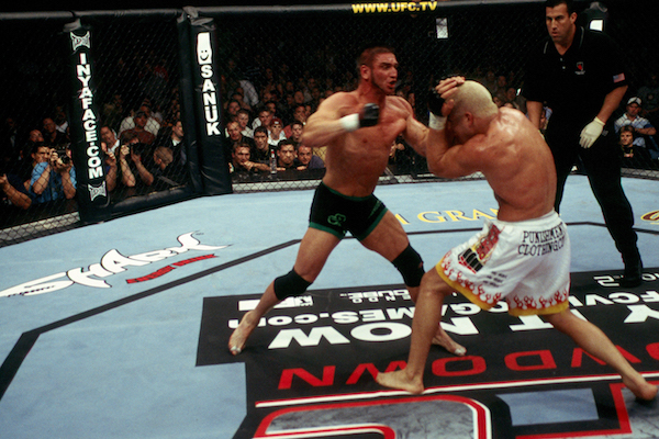 LAS VEGAS - APRIL 16: <a href='../fighter/Ken-Shamrock'>Ken Shamrock</a> punches Tito Ortiz during their bout at <a href='../event/UFC-52-Couture-vs-Liddell-II'>UFC 52 </a>at the MGM Grand Garden Arena on April 16, 2005 in Las Vegas, Nevada. (Photo by Josh Hedges/Zuffa LLC/Zuffa LLC via Getty Images)