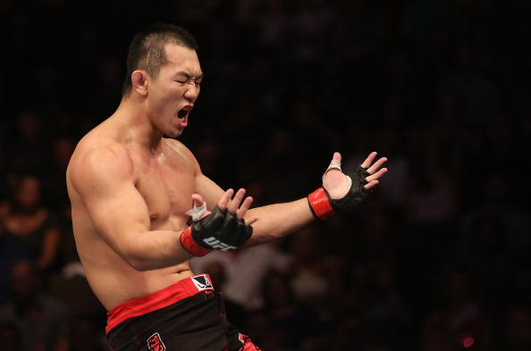 Yushin Okami reacts after defeating Buddy Roberts during their middleweight bout at UFC 150 inside Pepsi Center on August 11, 2012 in Denver, Colorado. (Photo by Nick Laham/Zuffa LLC)