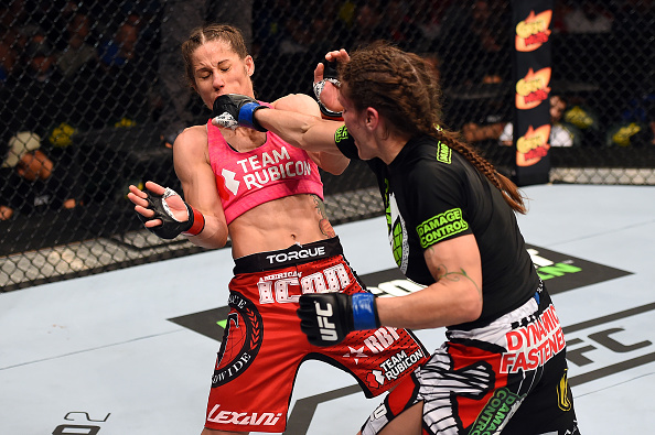 Lauren Murphy punches <a href='../fighter/Liz-Carmouche'>Liz Carmouche</a> in their women's bantamweight fight during the <a href='../event/UFC-Silva-vs-Irvin'>UFC Fight Night </a>event at the Patriot Center on April 4, 2015 in Fairfax, Virginia. (Photo by Josh Hedges/Zuffa LLC)