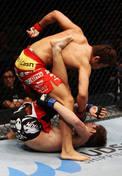 Dong Hyun Kim unleashes punches on <a href='../fighter/John-Hathaway'>John Hathaway</a> in their welterweight fight during the UFC Fight Night event at the Venetian Macau on March 1, 2014 in Macau. (Photo by Mitch Viquez/Zuffa LLC)
