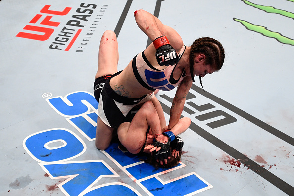 Lauren Murphy (top) punches Faszholz in their women's bantamweight bout during the UFC Fight Night event at Consol Energy Center on February 21, 2016 in Pittsburgh, PA. (Photo by Jeff Bottari/Zuffa LLC)