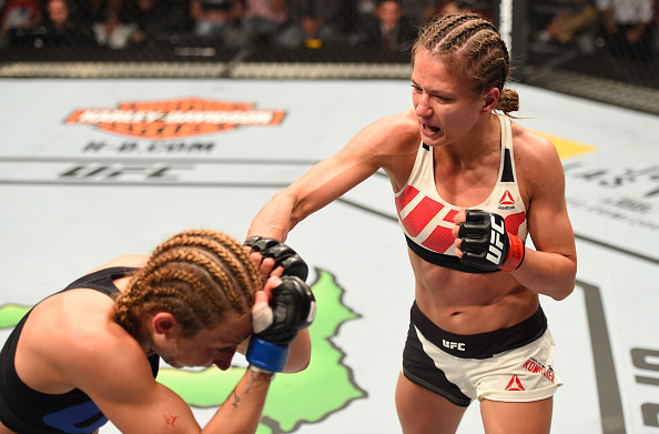 (R-L) Karolina Kowalkiewicz punches <a href='../fighter/Heather-Clark'><a href='../fighter/Heather-Clark'>Heather Jo Clark</a></a> in their women's strawweight bout during the UFC Fight Night event at Ahoy Rotterdam on May 8, 2016 in Rotterdam, Netherlands. (Photo by Josh Hedges/Zuffa LLC)