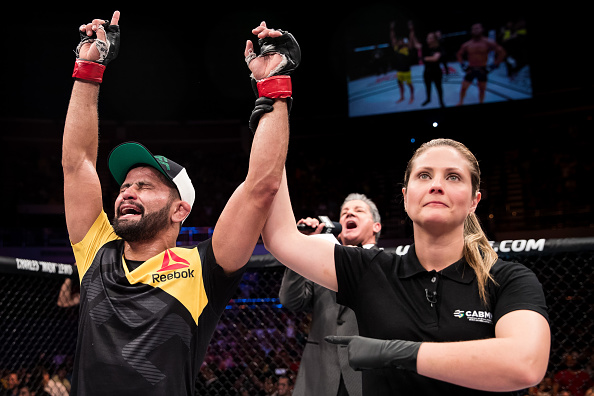 Jussier Formiga of Brazil celebrates victory over <a href='../fighter/Dustin-Ortiz'>Dustin Ortiz</a> of the United States in  their bantamweight UFC bout during the UFC Fight Night event at Nilson Nelson gymnasium on September 24, 2016 in Brasilia, Brazil. (Photo by Buda Mendes/Zuffa LLC)