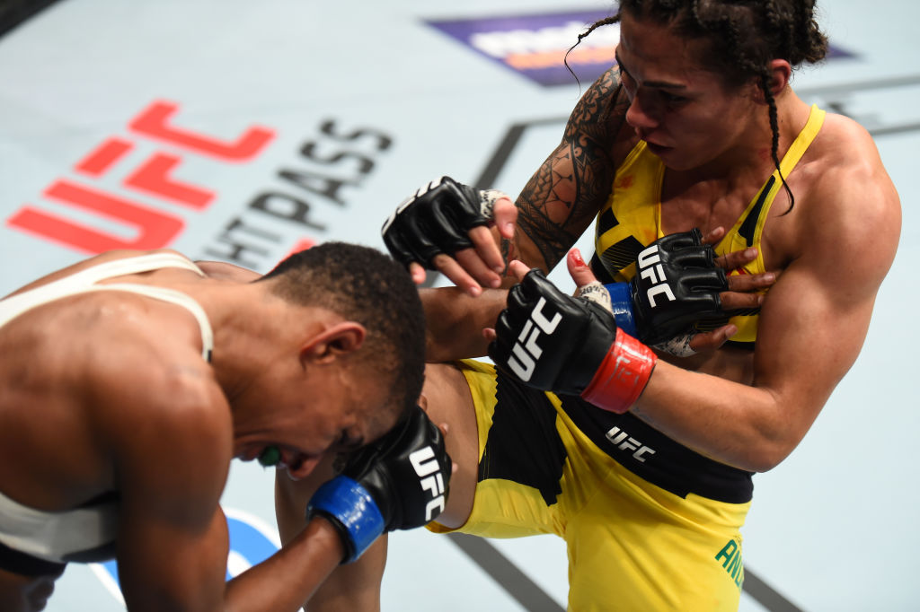 HOUSTON, TX - FEBRUARY 04:  (R-L) Jessica Andrade of Brazil knees Angela Hill in their women's strawweight bout during the UFC Fight Night event at the Toyota Center on February 4, 2017 in Houston, Texas. (Photo by Jeff Bottari/Zuffa LLC)