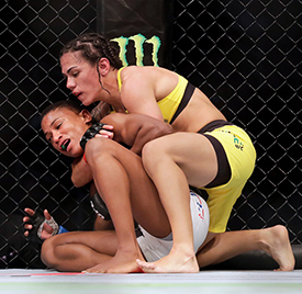 Jessica Andrade (yellow) attempts a choke hold on Angela Hill (white) in the Women's Strawweight Bout during <a href='../event/UFC-Silva-vs-Irvin'>UFC Fight Night </a>at the Toyota Center on February 4, 2017 in Houston, Texas.  (Photo by Tim Warner/Getty Images)