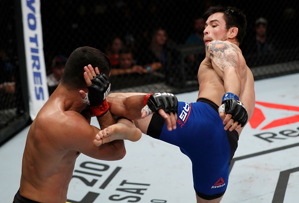 (R-L) Ray Borg kicks <a href='../fighter/jussier-formiga'><a href='../fighter/jussier-formiga'>Jussier Formiga</a></a> of Brazil in their flyweight bout during the <a href='../event/UFC-Silva-vs-Irvin'><a href='../event/UFC-Silva-vs-Irvin'>UFC Fight Night </a></a>event at CFO - Centro de Forma�co Olimpica on March 11, 2017 in Fortaleza, Brazil. (Photo by Buda Mendes/Zuffa LLC)