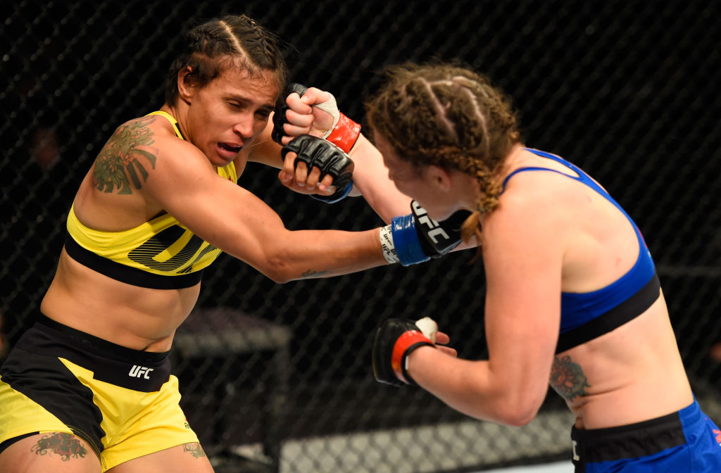 GLASGOW, SCOTLAND - JULY 16:  (R-L) Leslie Smith punches Amanda Lemos of Brazil in their women's bantamweight bout during the UFC Fight Night event at the SSE Hydro Arena Glasgow on July 16, 2017 in Glasgow, Scotland. (Photo by Josh Hedges/Zuffa LLC)