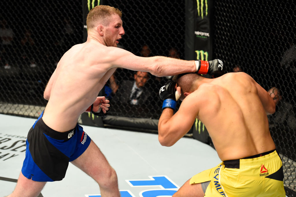 GLASGOW, SCOTLAND - (L-R) Danny Henry of Scotland punches Daniel Teymur of Sweden in their lightweight bout during the UFC Fight Night event at the SSE Hydro Arena Glasgow on July 16, 2017 in Glasgow, Scotland. (Photo by Josh Hedges/Zuffa LLC)
