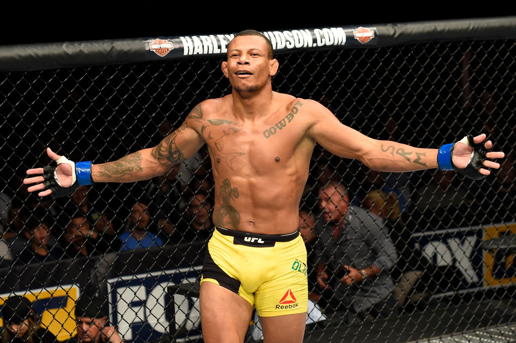 UNIONDALE, NY - JULY 22:  <a href='../fighter/alex-oliveira'>Alex Oliveira</a> of Brazil celebrates after defeating <a href='../fighter/Ryan-LaFlare'>Ryan LaFlare</a> in their welterweight bout during the UFC Fight Night event inside the Nassau Veterans Memorial Coliseum on July 22, 2017 in Uniondale, New York. (Photo by Josh Hedges/Zuffa LLC)