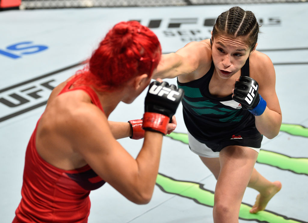 MEXICO CITY, MEXICO - AUGUST 05:  (R-L) &lt;a href='../fighter/alexa-grasso'&gt;<a href='../fighter/alexa-grasso'><a href='../fighter/alexa-grasso'>Alexa Grasso</a></a>&lt;/a&gt; of Mexico punches &lt;a href='../fighter/Randa-Markos'&gt;<a href='../fighter/Randa-Markos'><a href='../fighter/Randa-Markos'>Randa Markos</a></a>&lt;/a&gt; of Iraq in their women's strawweight bout during the &lt;a href='../event/UFC-Silva-vs-Irvin'&gt;<a href='../event/UFC-Silva-vs-Irvin'><a href='../event/UFC-Silva-vs-Irvin'>UFC Fight Night </a></a>&lt;/a&gt;event at Arena Ciudad de Mexico on August 5, 2017 in Mexico City, Mexico. (Photo by Jeff Bottari/Zuffa LLC)