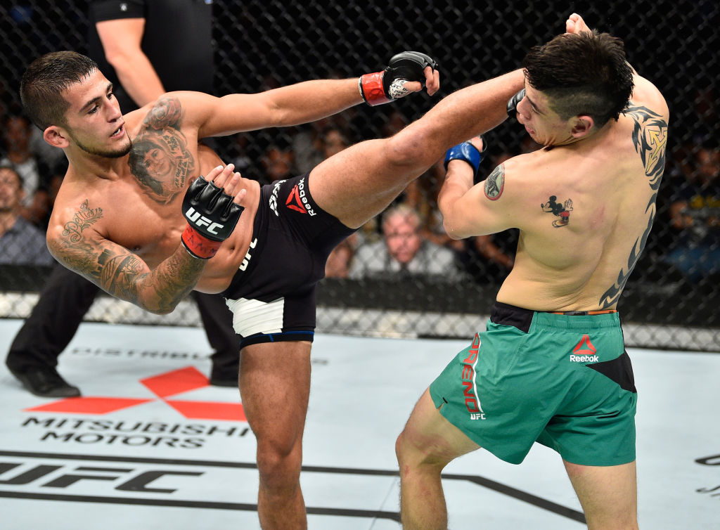 MEXICO CITY, MEXICO - AUGUST 05:  (L-R) Sergio Pettis kicks Brandon Moreno of Mexico in their flyweight bout during the UFC Fight Night event at Arena Ciudad de Mexico on August 5, 2017 in Mexico City, Mexico. (Photo by Jeff Bottari/Zuffa LLC)