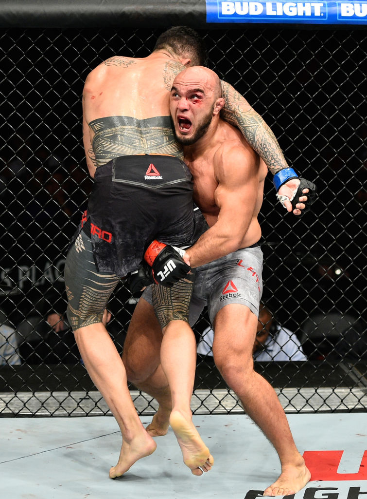 EDMONTON, AB - SEPTEMBER 09:  (R-L) <a href='../fighter/Ilir-Latifi'>Ilir Latifi</a> of Sweden takes down <a href='../fighter/tyson-pedro'>Tyson Pedro</a> of Australia in their light heavyweight bout during the UFC 215 event inside the Rogers Place on September 9, 2017 in Edmonton, Alberta, Canada. (Photo by Jeff Bottari/Zuffa LLC)
