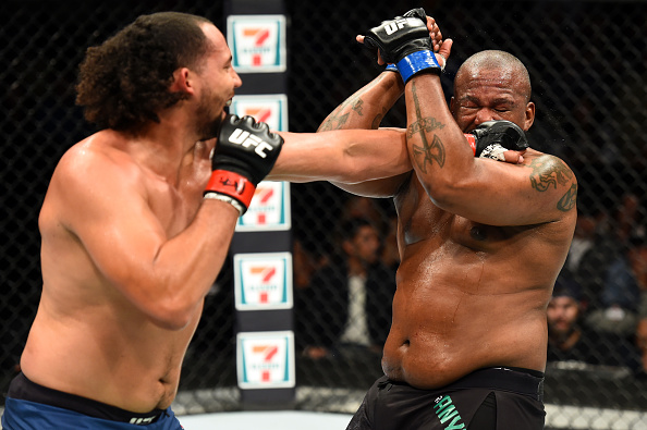 (L-R) Justin Ledet punches Zu Anyanwu in their heavyweight bout during the UFC Fight Night event inside the PPG Paints Arena on Sept. 16, 2017 in Pittsburgh, PA. (Photo by Josh Hedges/Zuffa LLC)