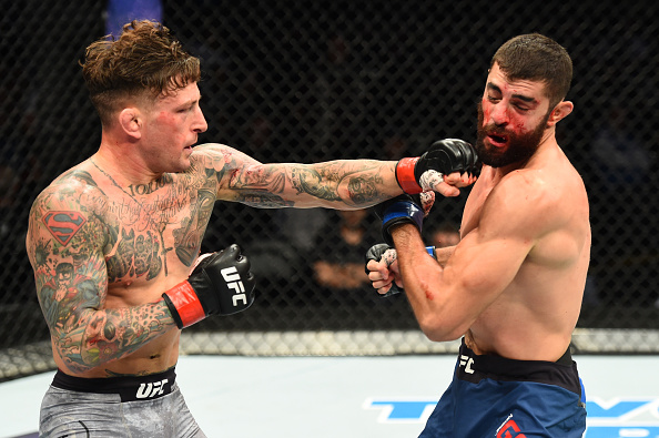 (L-R) Gregor Gillespie punches Jason Gonzalez in their lightweight bout during the UFC Fight Night event inside the PPG Paints Arena on September 16, 2017 in Pittsburgh, Pennsylvania. (Photo by Josh Hedges/Zuffa LLC)