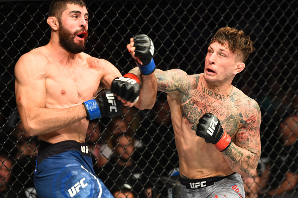 (L-R) Jason Gonzalez and Gregor Gillespie exchange punches in their lightweight bout during the UFC Fight Night event inside the PPG Paints Arena on September 16, 2017 in Pittsburgh, Pennsylvania. (Photo by Josh Hedges/Zuffa LLC)