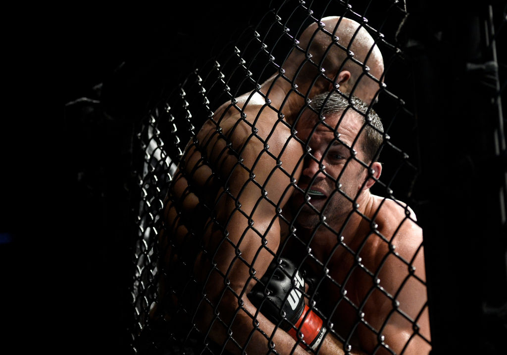 (R-L) <a href='../fighter/Luke-Rockhold'>Luke Rockhold</a> pushes <a href='../fighter/Dave-Branch'>David Branch</a> up against the cage in their middleweight bout during the <a href='../event/UFC-Silva-vs-Irvin'>UFC Fight Night </a>event inside the PPG Paints Arena on September 16, 2017 in Pittsburgh, Pennsylvania. (Photo by Brandon Magnus/Zuffa LLC)