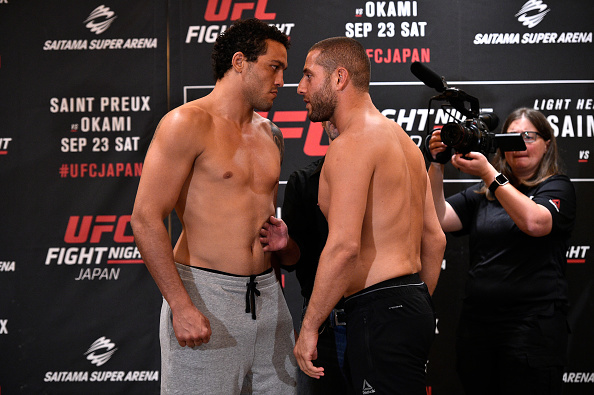 (R-L) Opponents Gokhan Saki of Netherlands and Henrique da Silva of Brazil face off during the UFC Fight Night Weigh-in at the Hilton Tokyo on Sept. 21, 2017 in Tokyo, Japan. (Photo by Jeff Bottari/Zuffa LLC)