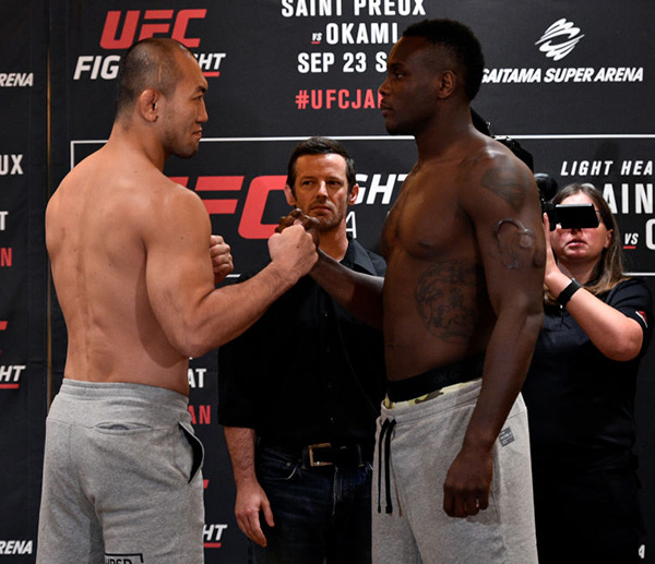 (R-L) Opponents <a href='../fighter/Ovince-St-Preux'>Ovince Saint Preux</a> of the United States and <a href='../fighter/Yushin-Okami'>Yushin Okami</a> of Japan face off during the <a href='../event/UFC-Silva-vs-Irvin'>UFC Fight Night </a>Weigh-in at the Hilton Tokyo on September 21, 2017 in Tokyo, Japan. (Photo by Jeff Bottari/Zuffa LLC)