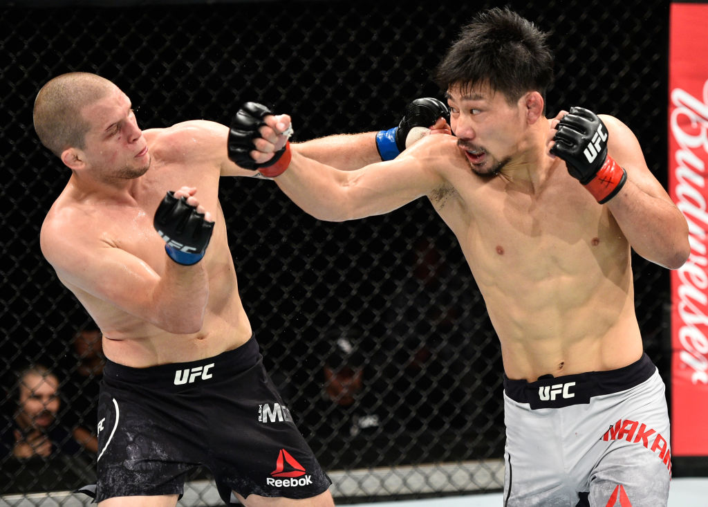 (R-L) Keita Nakamura of Japan punches Alex Morono in their welterweight bout during the UFC Fight Night event inside the Saitama Super Arena on September 22, 2017 in Saitama, Japan. (Photo by Jeff Bottari/Zuffa LLC)