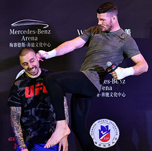 (L-R) <a href='../fighter/Dan-Hardy'>Dan Hardy</a> 'speaks' with Michael Bisping of England after his open workout session inside the Kerry Hotel Pudong on Nov. 23, 2017 in Shanghai, China. (Photo by Brandon Magnus/Zuffa LLC)