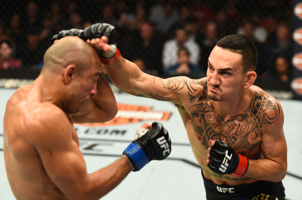 DETROIT, MI - DECEMBER 02: (R-L) Max Holloway punches Jose Aldo of Brazil in their UFC featherweight championship bout during the UFC 218 event inside Little Caesars Arena on December 02, 2017 in Detroit, Michigan. (Photo by Josh Hedges/Zuffa LLC)