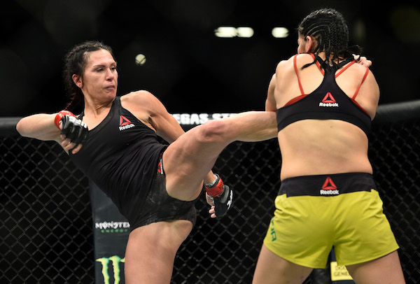 LAS VEGAS, NV - MARCH 03:   (L-R) <a href='../fighter/cat-zingano'>Cat Zingano</a> kicks <a href='../fighter/ketlen-vieira'>Ketlen Vieira</a> of Brazil in their women's bantamweight bout during the UFC 222 event inside T-Mobile Arena on March 3, 2018 in Las Vegas, Nevada. (Photo by Brandon Magnus/Zuffa LLC/Zuffa LLC via Getty Images)