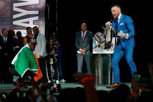 TORONTO, CANADA - JULY 12: (L-R) Floyd Mayweather Jr. and Conor McGregor interact on stage during the Floyd Mayweather Jr. v Conor McGregor World Press Tour event at the Staples Center on July 12, 2017 in Toronto, Ontario, Canada, California. (Photo by Jeff Bottari/Zuffa LLC/Zuffa LLC via Getty Images)