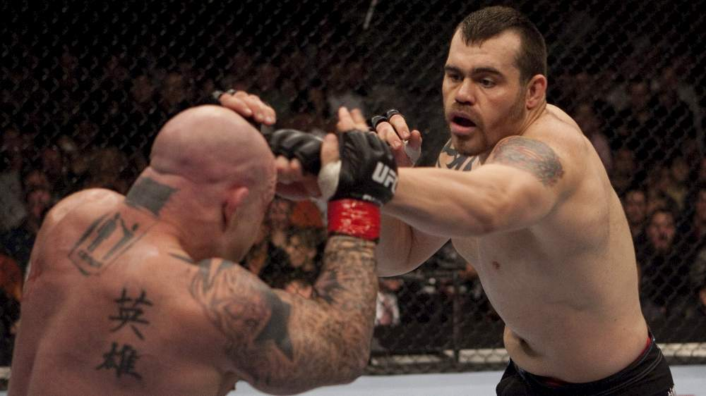SACRAMENTO, CA - NOVEMBER 18:  (R-L) Tim Sylvia punches Jeff Monson at  UFC 65 at the Arco Arena on November 18, 2006 in Sacramento, California.  (Photo by Josh Hedges/Zuffa LLC)