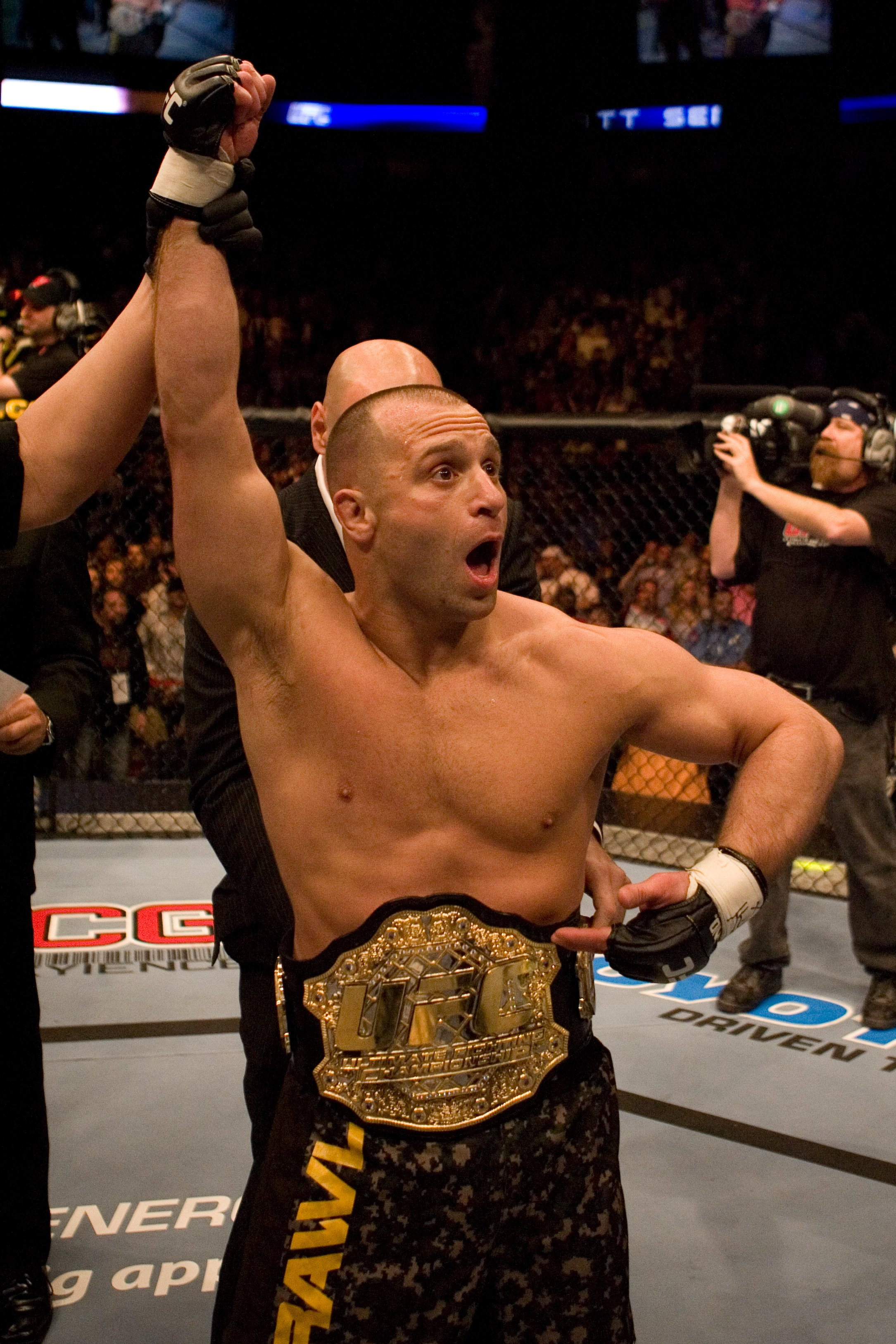 HOUSTON - APRIL 7: Matt Serra (brown/camo shorts) def. Georges St-Pierre (green shorts) - TKO - 3:25 round 1 during UFC 69 at Toyota Center on April 7, 2007 in Houston, Texas. (Photo by Josh Hedges/Zuffa LLC)