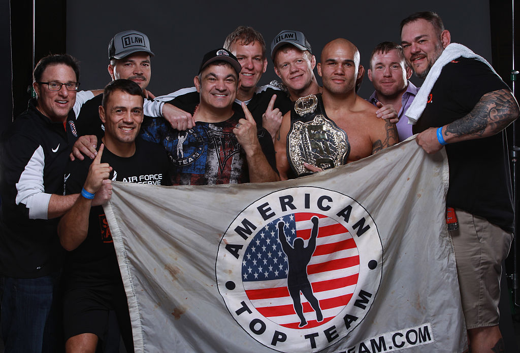 LAS VEGAS, NV - DECEMBER 06:  UFC welterweight champion Robbie Lawler poses backstage for a post fight portrait with his team during the UFC 181 event inside the Mandalay Bay Events Center on December 6, 2014 in Las Vegas, Nevada.  (Photo by Mike Roach/Zuffa LLC)