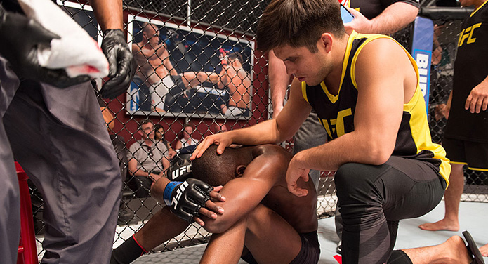 LAS VEGAS, NV - JULY 15:  (R-L) Head coach Henry Cejudo consoles Nkazimulo Zulu after his submission loss to Hiromasa Ogikubo during the filming of The Ultimate Fighter: Team Benavidez vs Team Cejudo at the UFC TUF Gym on July 15, 2016 in Las Vegas, Nevada. (Photo by Elliot Howard/Zuffa LLC)