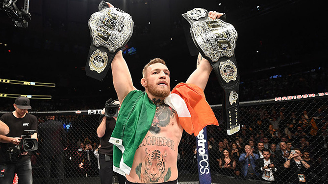 NEW YORK, NY - NOVEMBER 12: UFC lightweight and featherweight champion Conor McGregor of Ireland celebrates after defeating Eddie Alvarez in their UFC lightweight championship fight during the UFC 205 event at Madison Square Garden on November 12, 2016 in New York City. (Photo by Jeff Bottari/Zuffa LLC)