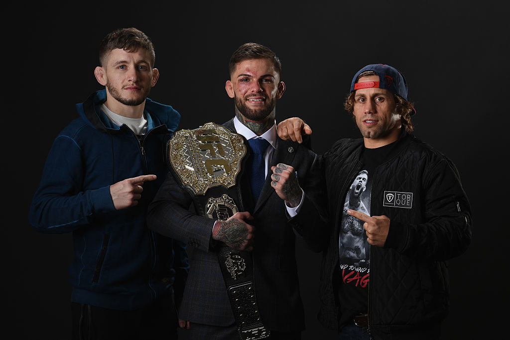LAS VEGAS, NV - DECEMBER 30:  UFC bantamweight champion Cody Garbrandt (C) poses with Urijah Faber (R) and Chris Holdsworth backstage during the UFC 207 event at T-Mobile Arena on December 30, 2016 in Las Vegas, Nevada.  (Photo by Mike Roach/Zuffa LLC)
