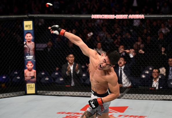 SHANGHAI, CHINA - NOVEMBER 25: <a href='../fighter/Yadong-Song'>Song Yadong</a> of China celebrates after his victory over <a href='../fighter/Bharat-Kandare'>Bharat Kandare</a> in their featherweight bout during the <a href='../event/UFC-Silva-vs-Irvin'>UFC Fight Night </a>event inside the Mercedes-Benz Arena on November 25, 2017 in Shanghai, China. (Photo by Brandon Magnus/Zuffa LLC via Getty Images)
