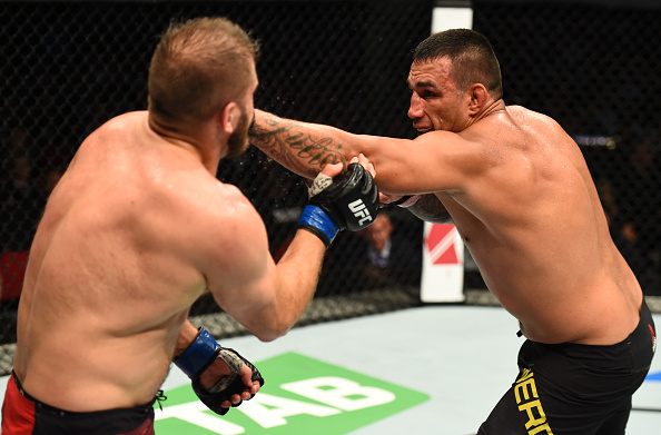 SYDNEY, AUSTRALIA - NOVEMBER 19: (R-L) Fabricio Werdum of Brazil punches Marcin Tybura of Poland in their heavyweight bout during the UFC Fight Night event inside the Qudos Bank Arena on November 19, 2017 in Sydney, Australia. (Photo by Josh Hedges/Zuffa LLC/Zuffa LLC via Getty Images)