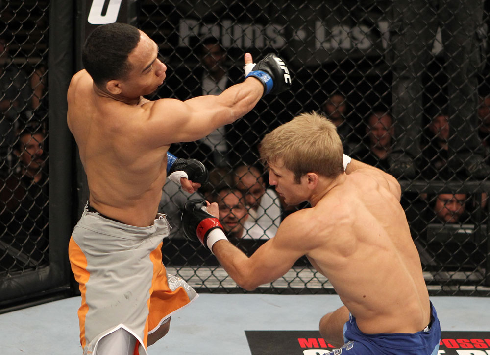 John Dodson follows up on a punch on TJ Dillashaw during The Ultimate Fighter 14 Finale on December 3, 2011 in Las Vegas, NV. (Photo by Josh Hedges/Zuffa LLC)