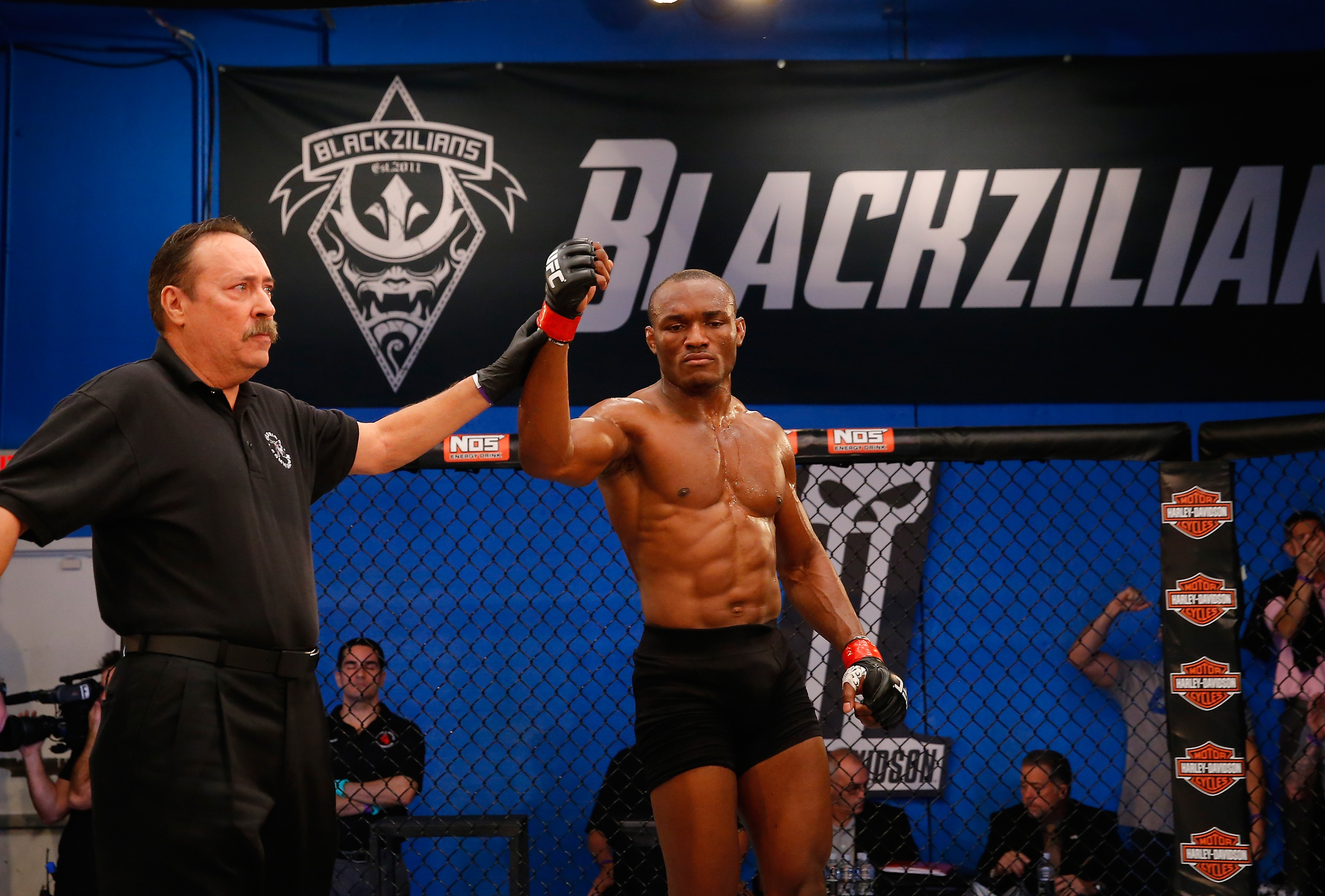 BOCA RATON, FL - JANUARY 27: Kamarudeen Usman celebrates his victory over Michael Graves during the filming of The Ultimate Fighter: American Top Team vs Blackzilians on January 27, 2015 in Boca Raton, Florida. (Photo by Christopher Trotman/Zuffa LLC/Zuffa LLC via Getty Images)
