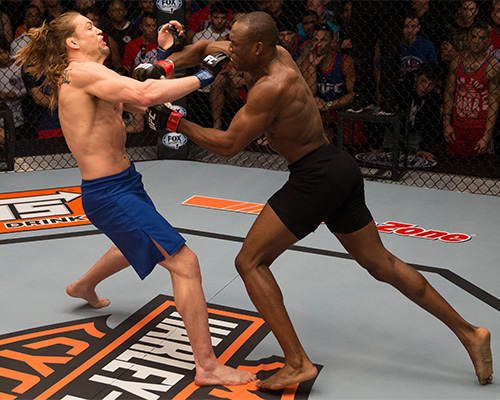 (R-L) Kamarudeen Usman punches Steve Carl during the filming of The Ultimate Fighter: American Top Team vs Blackzilians on February 24, 2015 in Coconut Creek, Florida. (Photo by Chris Trotman/Zuffa LLC)