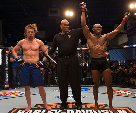 (R-L) Kamarudeen Usman celebrates his victory over Steve Carl during the filming of The Ultimate Fighter: American Top Team vs Blackzilians on February 24, 2015 in Coconut Creek, Florida. (Photo by Chris Trotman/Zuffa LLC)