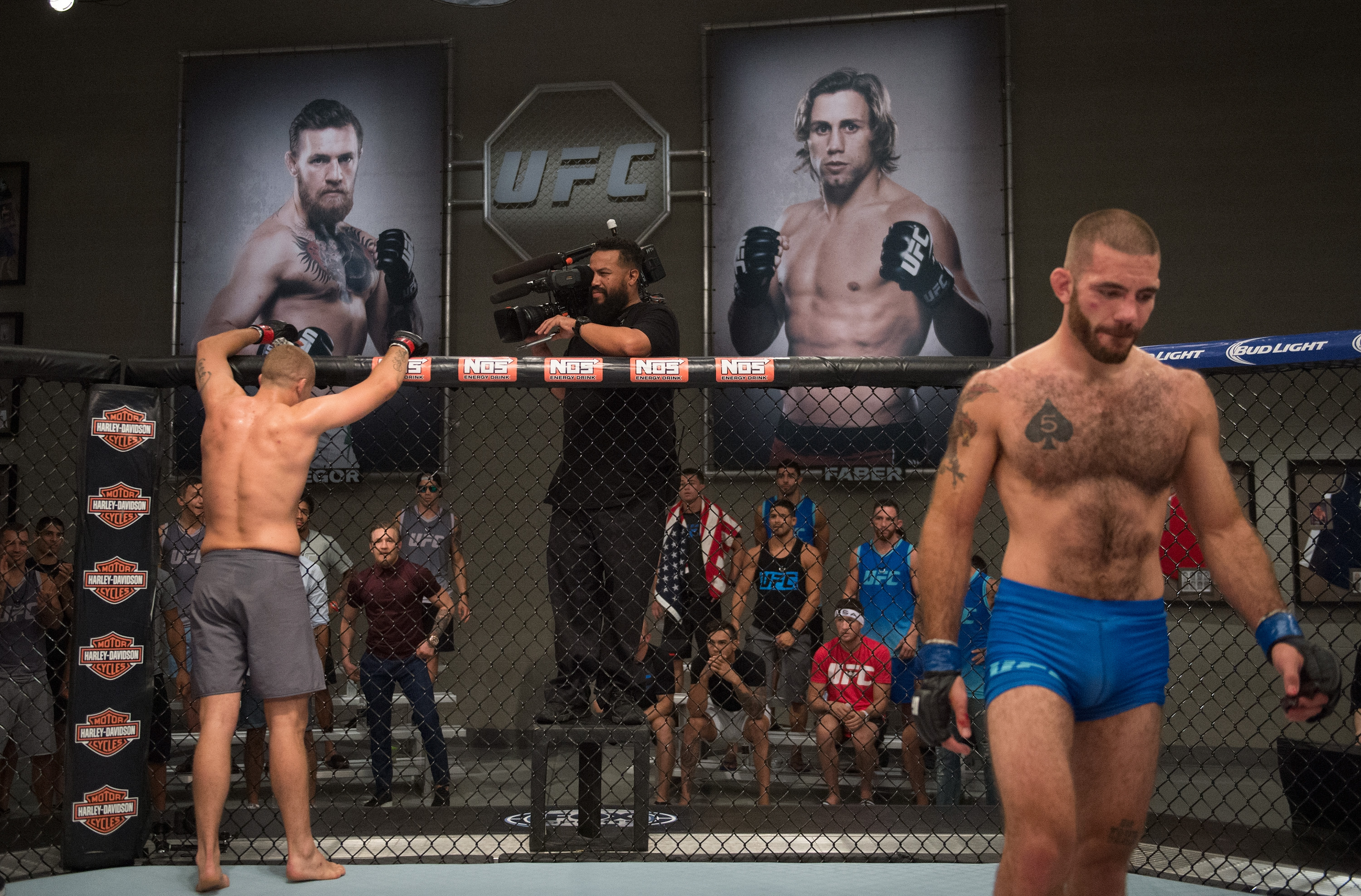 (L-R) Marcin Wrzosek raises his hands after his fight against Tom Gallicchio during the filming of The Ultimate Fighter: Team McGregor vs Team Faber at the UFC TUF Gym on July 30, 2015 in Las Vegas, Nevada. (Brandon Magnus/Zuffa LLC)