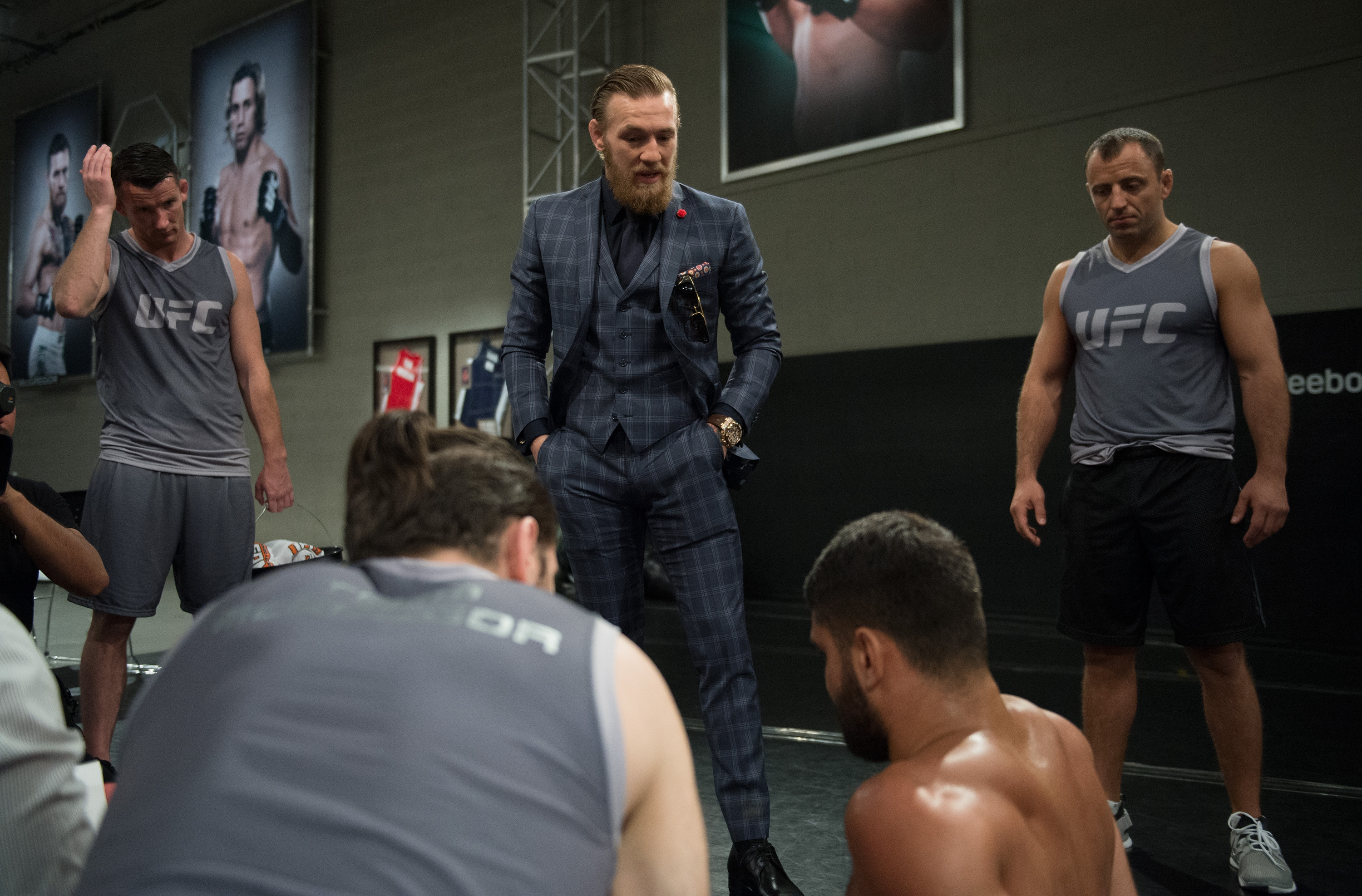 Head Coach Conor McGregor talks to his team after Frantz Slioa's submission loss to Ryan Hall during the filming of The Ultimate Fighter: Team McGregor vs Team Faber. (Brandon Magnus/Zuffa LLC)