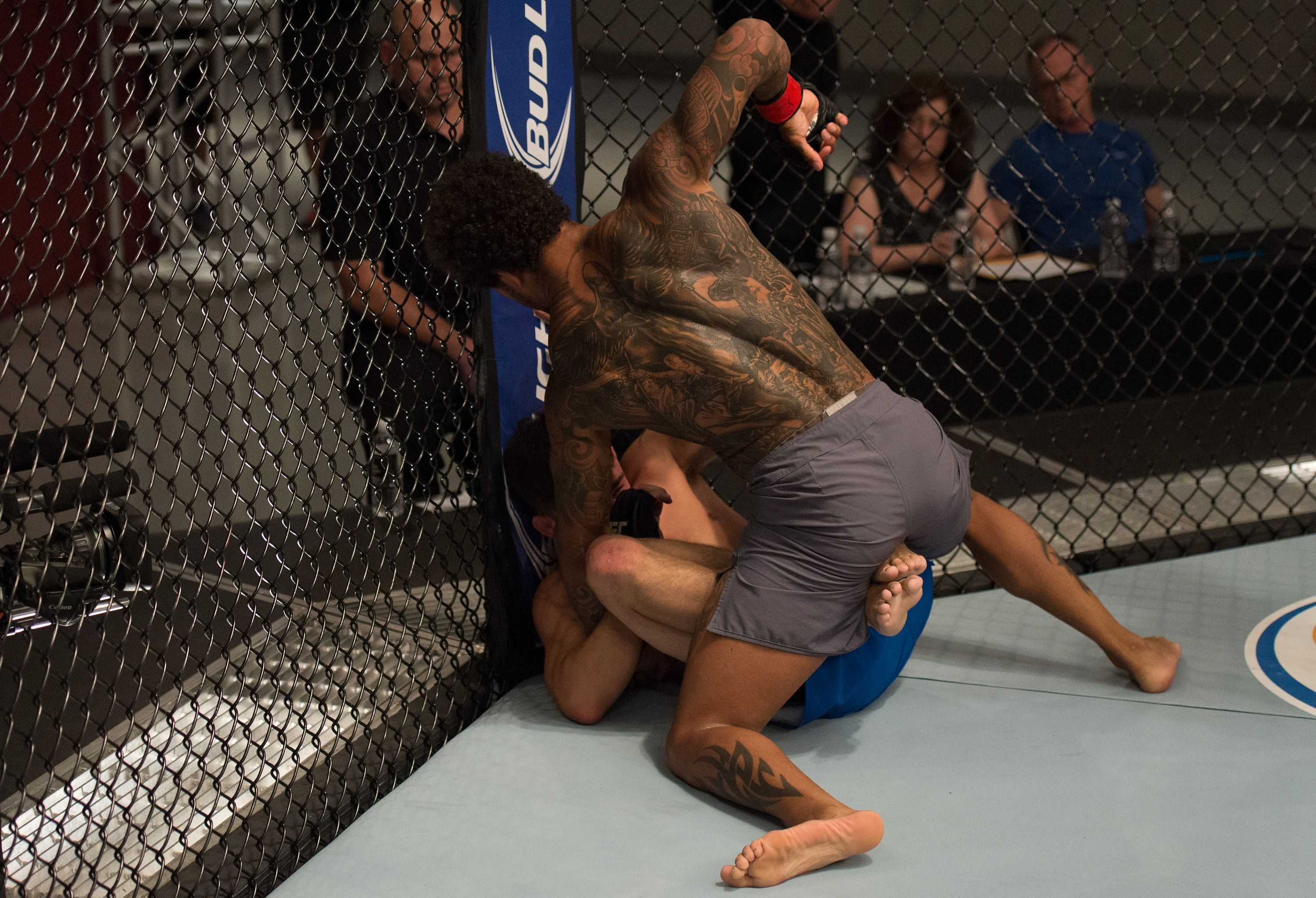 Saul Rogers (top) punches Billy Quarantillo during the filming of The Ultimate Fighter: Team McGregor vs Team Faber at the UFC TUF Gym on August 3, 2015 in Las Vegas, Nevada. (Photo by Brandon Magnus/Zuffa LLC)