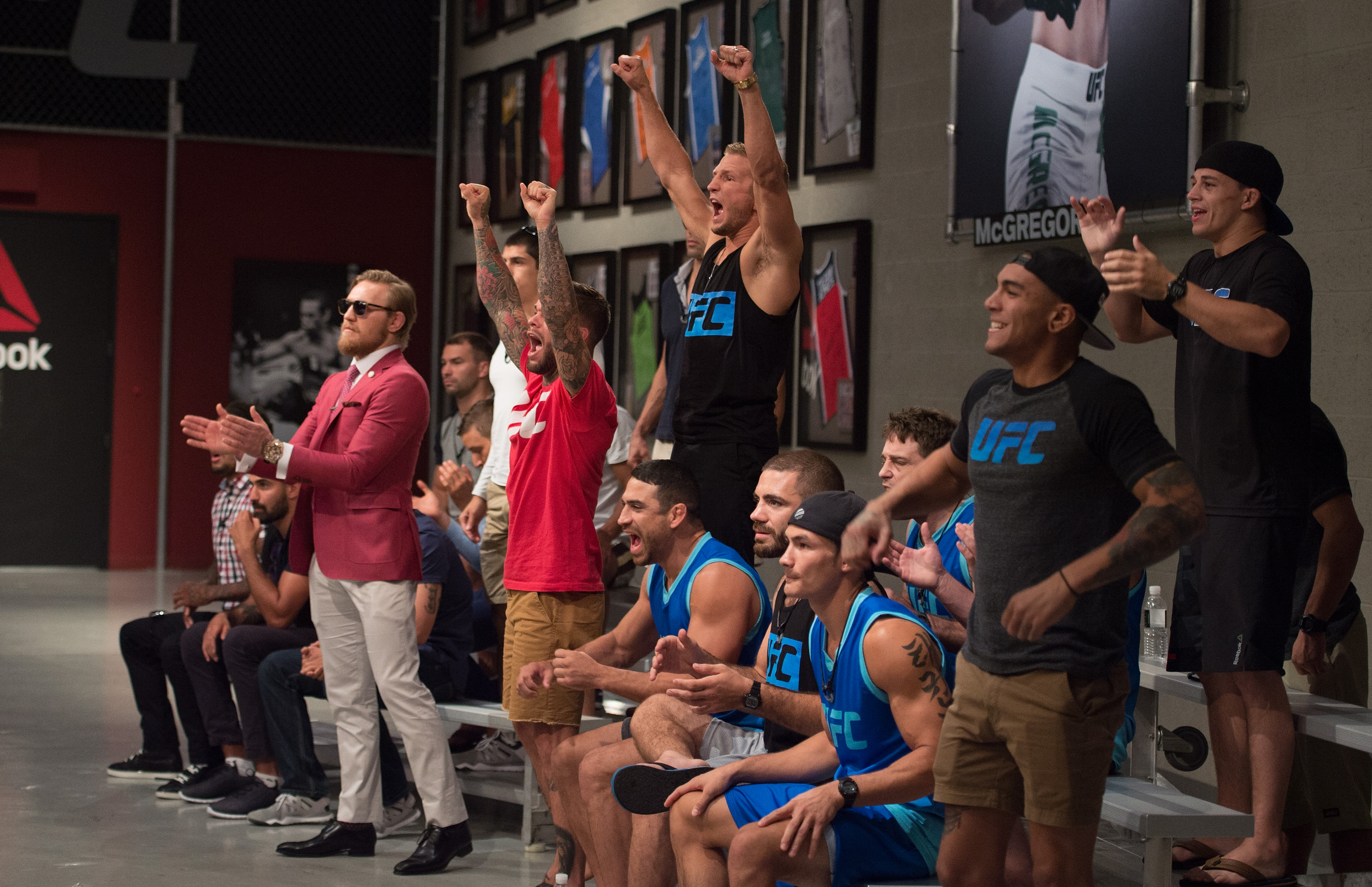Team McGregor and Team Faber cheer as they watch Mehdi Baghdad face Julian Erosa during the filming of The Ultimate Fighter: Team McGregor vs Team Faber at the UFC TUF Gym on August 5, 2015 in Las Vegas, Nevada. (Photo by Elliot Howard/Zuffa LLC)