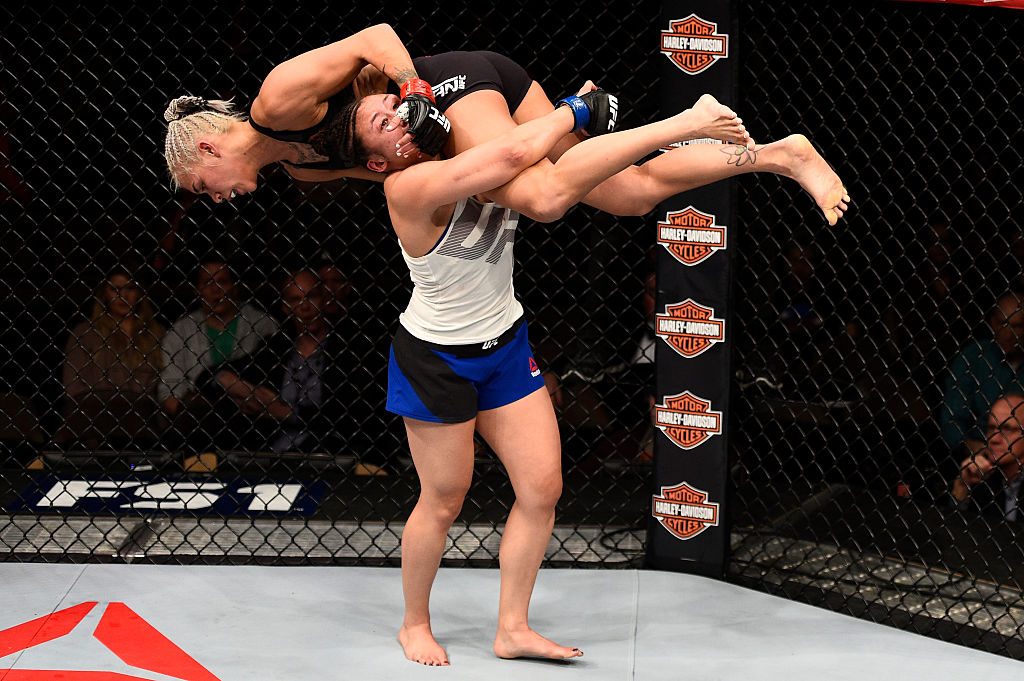 LAS VEGAS, NV - DECEMBER 03: (L-R) Jamie Moyle takes down Kailin Curran in their women's strawweight bout during The Ultimate Fighter Finale event inside the Pearl concert theater at the Palms Resort & Casino on December 3, 2016 in Las Vegas, Nevada. (Photo by Jeff Bottari/Zuffa LLC)