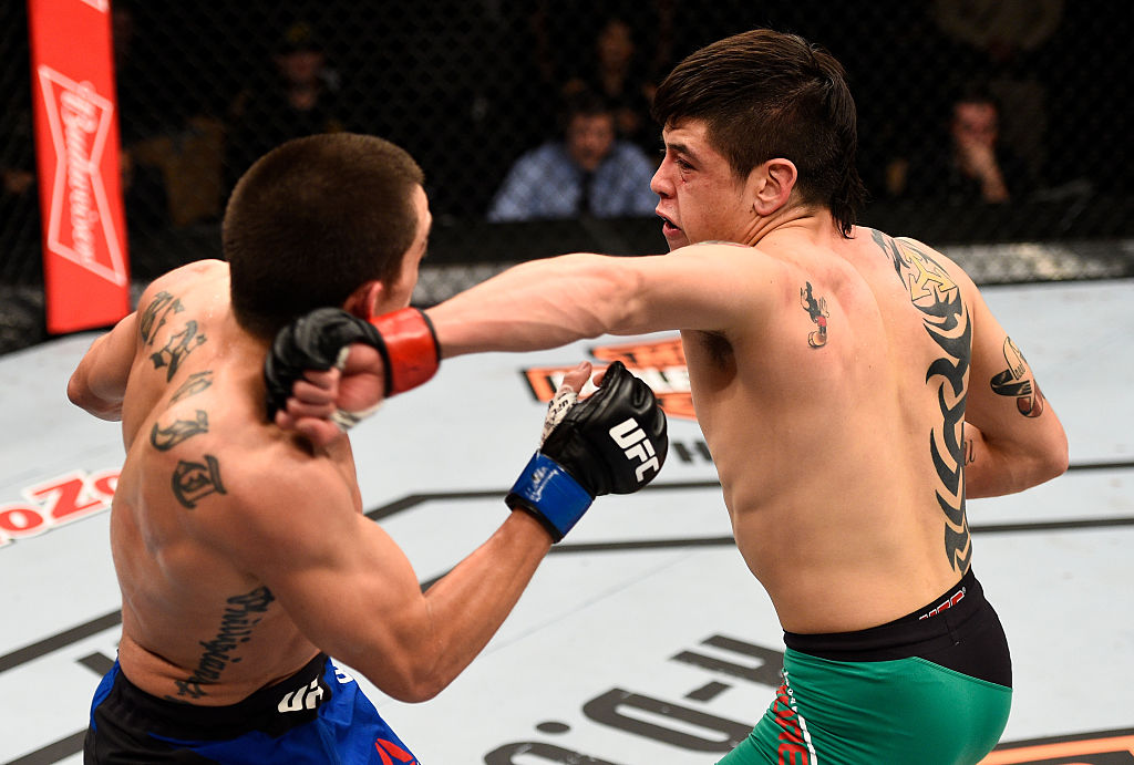 LAS VEGAS, NV - DECEMBER 03: (R-L) Brandon Moreno of Mexico punches Ryan Benoit in their flyweight bout during The Ultimate Fighter Finale event inside the Pearl concert theater at the Palms Resort & Casino on December 3, 2016 in Las Vegas, Nevada. (Photo by Jeff Bottari/Zuffa LLC)