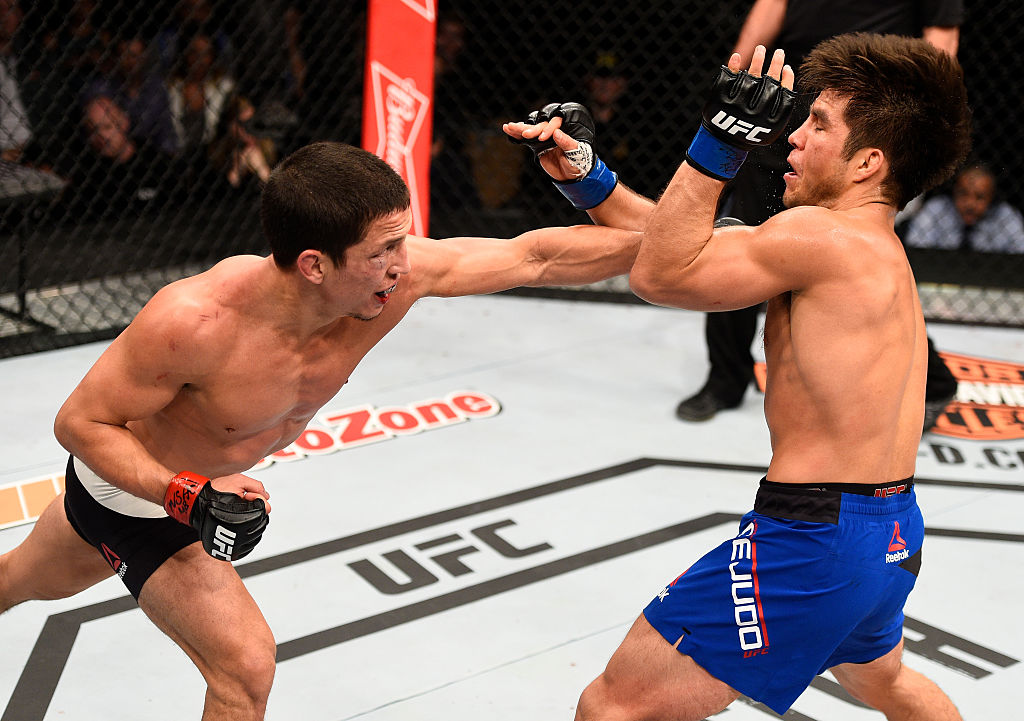 LAS VEGAS, NV - DECEMBER 03: (L-R) Joseph Benavidez punches Henry Cejudo in their flyweight bout during The Ultimate Fighter Finale event inside the Pearl concert theater at the Palms Resort & Casino on December 3, 2016 in Las Vegas, Nevada. (Photo by Jeff Bottari/Zuffa LLC)