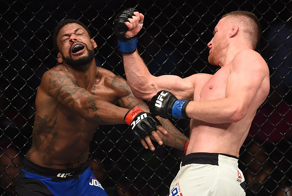 LAS VEGAS, NV: (R-L) Justin Gaethje punches Michael Johnson in their lightweight bout during <a href='../event/The-Ultimate-Fighter-T-Rampage-vs-T-Forrest-Finale'><a href='../event/The-Ultimate-Fighter-Finale-Team-Nog-vs-Team-Mir'><a href='../event/The-Ultimate-Fighter-Team-Liddell-vs-Team-Ortiz-FINALE'><a href='../event/TUF13-finale'><a href='../event/the-ultimate-fighter-a-champion-will-be-crowned'>The Ultimate Fighter Finale </a></a></a></a></a>at T-Mobile Arena on July 7, 2017 in Las Vegas, Nevada. (Photo by Brandon Magnus/Zuffa LLC)